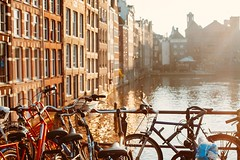 Amsterdam golden hour (spiridono) Tags: amsterdam city view canal netherlands golden hour sun light water cityscape architecture europe bicicles