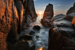Sunlight (Jackie Tran Anh) Tags: sun sunshine sunlight light sunrise sunset sunburst star rocks sea seascape outdoor outdoors landscape longexposure asia cost water waves reflection mountains ocean clouds sky morning