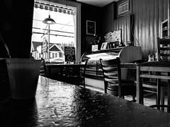 Vermont Flavors (Szoki Adams) Tags: jeffersonville vermont restaurant moody indoors chairs tables blackandwhite bw blackwhitephotos canong15