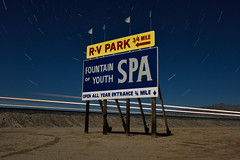 fountain of youth. bombay beach, ca. 2016. (eyetwist) Tags: eyetwistkevinballuff eyetwist fountainofyouth spa sign train bombaybeach type typography saltonsea night desert dark nikon nikond7000 d7000 nikkor capturenx2 1024mmf3545g 1024mm fullmoon photography gel tripod npy nocturne longexposure derelict lightpainting ruin california imperial sonorandesert sonoran salton sea shoreline startrails american west typographic signgeeks lettering pennant bombay beach freight streaks light headlight up ca111 fountain youth rv park trailerpark