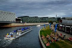 Relaxing Berlin (shlomo2000) Tags: spree capital hauptstadt riverside ufer summer boat relax river ship xpro1 xf23f14 35mm city deutschland modern architecture fluss outside