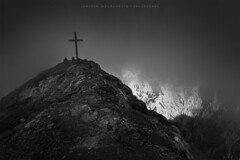 Hidden in the clouds (wende60) Tags: mountains peak cross clouds fog dark bw alps light darkness