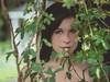 Secrets 2 (Vincent F Tsai) Tags: girl portrait fashion art eyes stare young freckles brunette framing vines leaves obscured olympusmzuiko75mmf18 panasonic lumixg5