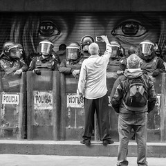 Eye, Eye, Trouble on the Streets (Geraint Rowland Photography) Tags: mexicocity mexicopolice protest violence districtofederal blackandwhitephotography streetphotography geraintrowlandphtography video filming filmingthepolice policebrutality policia documentaryphotographybygeraintrowland streetart eye eyes