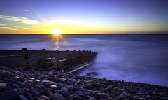 Sunrise (Red King (Rory)) Tags: beach sea seascape sky sunrise blue sun groyne amroth pembrokeshire wales