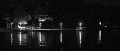 Reflection (LifeIsGhood) Tags: light white lake ontario canada black reflection monochrome club night canon dark lens 50mm prime lights yacht low sigma noise muskoka beaumaris noisy byc 500d