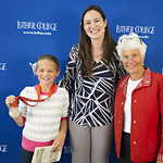 """<b>Aquatic Center Dedication of Service_100413_0241</b><br/> Photo by Zachary S. Stottler Luther College '15  Above: Christine Magnuson, two time Olympic Silver Medal winner, poses with various fans at the Luther College Service of Dedication for the new Aquatic Center.<a href=""""http://farm6.static.flickr.com/5495/10095981614_f33d082160_o.jpg"""" title=""""High res"""">∝</a>"""