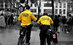 Boys in Yellow (.sarah444.) Tags: city urban blackandwhite bw yellow downtown hamilton police selectivecolor selectivecolour hamiltonpolice