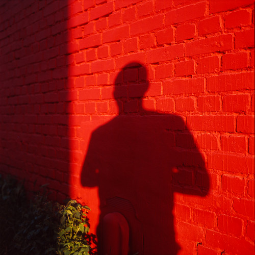 My shadow on a red wall.