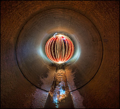 Red Sparky (Rodrick Dale) Tags: red lightpainting reflections orb sparkler sewer culvert