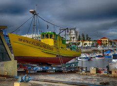 Flor Da Felicadade - Dry Dock II (rschnaible (Off - Back In June)) Tags: fish color portugal yellow clouds work boats harbor boat wooden fishing dock colorful day waterfront cloudy harbour dry setubal fleet hdr commerical