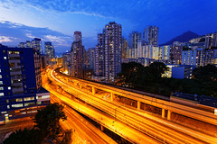 busy highway train traffic night in finance urban (cozyta) Tags: china city travel blue light sky urban black building tower art cars tourism beautiful skyline architecture modern night skyscraper landscape asian hongkong moving office colorful asia downtown neon view traffic district chinese fast center scene hong kong business busy metropolis tall economic jam kowloon financial economy finance
