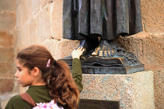Cceres (-zee) Tags: espaa feet church girl statue bronze gold spain cathedral touch young lucky cceres rub extremadura medievalcity