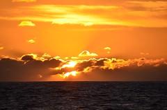 Cloud splitter (Jason Fairbairn Photography) Tags: ocean sunset orange usa cloud sun water sunshine clouds waikiki waikikisunset