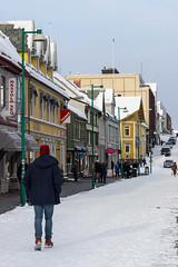 Storgata street (NykO18) Tags: road street people snow building sign norway person europe manmade housing nordnorge troms troms naturalelement