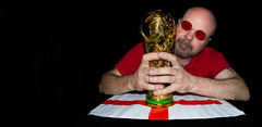 FIFA World Cup Trophy, a replica. . . (CWhatPhotos) Tags: fifa world cup trophy replica gold red england saint st georges cross george portrait self shades sun glasses comeonengland come crop prime photographs photograph pics pictures pic picture image images foto fotos photography artistic cwhatphotos that have which with contain taken wide fisheye eye fish 65mm samyang lens f35 75mm 75 football footy foot ball