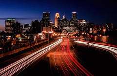 City Slickers (Doug Wallick) Tags: light urban minnesota skyline long exposure minneapolis overpass pedestrian interstate 35w streakshighway