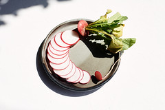 radish-sliced (miyukim26) Tags: naturallight radish ceramic plate nikond600 alienskin exposurex2 diybackdrop freshproduce vegetable red