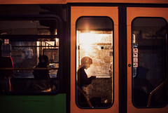 sun block (ewitsoe) Tags: sun autumn morning silhouette tram window woman rider commuter ewitsoe nikon d80 35mm street urban city mpk poland poznan polska sunny dawn early
