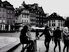 The Streets of Warsaw (David_Blair) Tags: warsaw poland bw blackandwhite street streets buildings stone stones musicalinstrumet music accordion busker nikoncoolpix nikoncoolpixl840 nikon coolpix l840 perspective