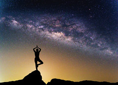 Landscape with Milky way galaxy. Night sky with stars and silhouette woman practicing yoga on the mountain. (Nuttawut Uttamaharad) Tags: astronomy background beauty black blue bright clear constellation cosmic cosmos dark exposure field galaxy landscape light long milky mountain nature nebula night observatory outdoors over panorama panoramic planet science silhouette sky space star summer telescope travel universe way woman practicing yoga sport fitness