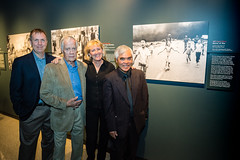 Four Pulitzer-Prize winning photographers and the evening's panelists: Smiley Pool, Robert Jackson, Carol Guzy and Nick Ut, next to Ut's award winning photo.
