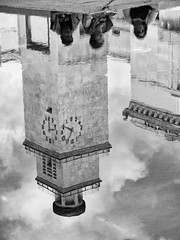 Vite riflesse B&W (Riccardo Palazzani - Italy) Tags: maratonafotografica vittoria piazza reflection tower clock orologio brescia children bambini fountain fontana water specchio acqua mirror wow omd em1 lombardei   lombardie  lombardia   italia italie italien italy   itlia itali  italya   riccardo palazzani veridiano3 olympus torre time victory riflessi reflections blur blurred