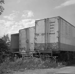 Customer Service (geowelch) Tags: thejunction toronto urbanfragments urbanlandscape film 120 6x6 mediumformat kodakportra400bw c41 trailers transport epsonperfection4870photo yashicamat