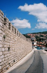 Wall with castellations (Song-to-the-Siren) Tags: summer stone wall clouds 35mm croatia bluesky 35mmfilm analogue dubrovnik adriatic konicahexaraf castellations 2013 kodakektar100