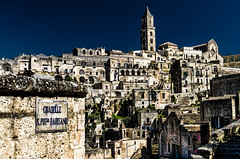 Matera - Southern Italy (Photos On The Road) Tags: old city blue light sky urban italy house building heritage tourism church horizontal stone architecture night buildings landscape outside outdoors lights town ancient europa europe italia cityscape view cathedral outdoor blu hill noone nobody nopeople landmark panoramic historic basilicata belltower unesco chiesa campanile southern belfry cielo vista historical urbano typical matera sassi oldtown pietra turismo azzurro borgo architettura paesaggio collina fascinating edifici cattedrale rupestre lucania tipico nessuno outdoorshots meridionale rupestrian orizzontale characteristic outdoorshot citt