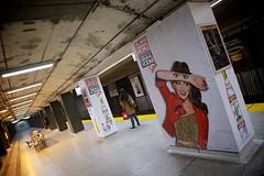 Peekaboo (cookedphotos) Tags: woman toronto station canon subway eyes angle ttc peekaboo diagonal advertisement commute wait stoli vodka stolichnaya standrew project365 365project 5dmarkii