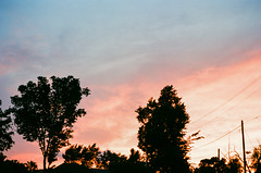97410014 (alexdotbarber) Tags: sunset 35mmfilm nikonfe2 colorfilm colornegative kodakektar100 houstonfourthward