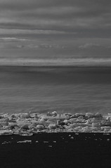 Sea at night (gunnarmh) Tags: winter sea bw ice beach night photography iceland movement photos