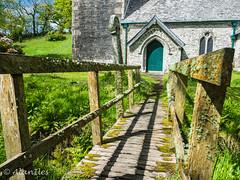 Footbridge to Lesnewth church (Alan Iles) Tags: door wood bridge green church st michael cornwall all footbridge near 5 north entrance angels lichen lightroom boscastle gf6 lesnewth