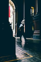 Ever Furious (c. Melon Images) Tags: street city light shadow urban man motion philadelphia silhouette yellow walking fuji cigarette candid smoke slowshutter philly cigarettesmoke 23mm vsco lr5 x100s