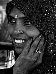 RAJASTHAN - Pushkar - Elle tenait au restaurant à la foire aux chameaux et elle était également chanteuse dans un orchestre Bhopa (Gilles Daligand) Tags: bhopa chanteuse foireauxchameaux inde orchestre portraitdefemme pushkar rajasthan noiretblanc monochrome bapu panasonic tz7 ngc papu