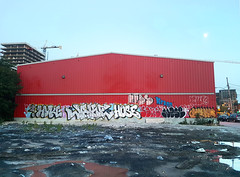 Griffintown Graffiti (Coastal Elite) Tags: graffiti griffintown throwup streetart building red house édifice rouge urban urbain montreal wall mur street art graffitis throwups industrial bubbly montréal letters lettres hose hyke wake parking vacant lot rain rainy puddle puddles gravel