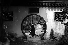 (cherco) Tags: alone lonely china woman girl circle circulo gate puerta temple templo tree arbol blackandwhite silhouette silueta blancoynegro composition composicion canon shangai