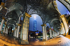 - Taipei Xinyi District - TAIWAN (urbaguilera) Tags:       101       taipei101 taiwan xinyi district cathay pacific united bank financial center arch urban design skyscraper plaza architecture asia city skyline outdoor building facade urbaguilera danielaguilera nikon fisheye lens 16mm f28 long exposure nikkor arcade public space blue hour nocturne night