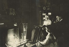 Three generations gaze at a glowing fire (sctatepdx) Tags: vintagefamily antiquephoto vernacular antiquefireplace fireplace antiquefireplacetools family antiquefamily