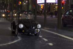 Baby you can drive my car.... (Catching_alchemic light) Tags: macro composite compostion street road losangeles la headlights people business nighttime beatle beetle car miniture mini tiny paper chalk staged redlight streetlights downtown song lyric drive auto automobile brand black