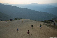 locals playing football in the hills below Darjeeling, West Bengal, India (Christian Loader) Tags: christianloader india sikkim westbengal mountain landscape sky cloud game football remote sunset playing ball