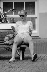 talk with your hands (105mm) Tags: street portrait people woman sun sexy girl smile dutch sunglasses amsterdam fashion portraits happy outfit women phone candid style streetlife skirt blond streetwear mensen streetfashion streetportraits streetstyle