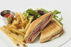 Panini with Ham French Fries and Salad (JPLPhotographyPDX) Tags: food white hot macro green cooking closeup cheese dinner french bread lunch cuisine restaurant salad italian warm ketchup plate ham sandwich bistro gourmet potato fries american meal organic sliced melted grilled panini