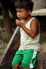 Little Amazon Boy (cowyeow) Tags: poverty travel girls boy portrait cute peru latinamerica southamerica boys girl kids river children amazon rainforest village child little candid small watching poor young attitude hut jungle tropical mean local littleboy bully tough loreto indigenous peruvian amazonriver