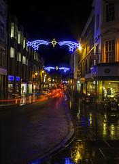 Shoplatch (orrellsphoto) Tags: street blue red wet yellow night lights trails shrewsbury