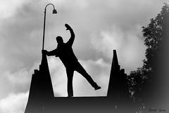 Leaning on a lampost (Rachelkeane82) Tags: bridge man lamp silhouette post oxford