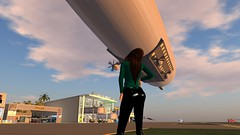 Watching the blimp take off (alexandriabrangwin) Tags: woman alexandria computer flying 3d airport dangerous graphics secondlife virtual blimp cgi airfield brangwin