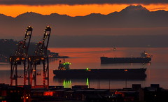 Christmas Day Shoot - Port of Seattle (DonnaRead50) Tags: seattle sunset red reflection water port gold washington ship crane ships cranes freighter freighters