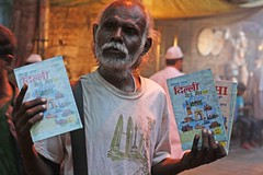A Seller of Delhi Guide (Mayank Austen Soofi) Tags: old portrait book delhi elderly vendor guide walla